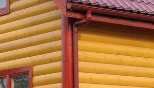 Облицовка дома металлосайдингом под брус