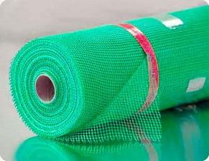 Рулон светло-зеленой фасадной сетки
