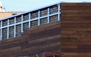 Пример облицовки фасада деревянными панелями