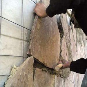 Процесс кладки камня для облицовки