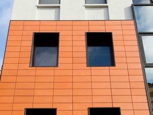 Облицовка оранжевами плитками
