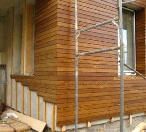 Отделка частного дома искусственным камнем фасада дома фото