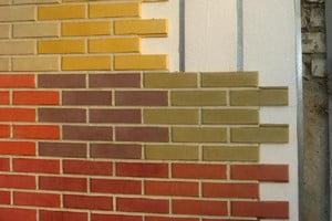 Разноцветные фасадные панели под кирпич