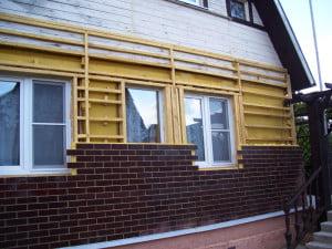 Отделанный  термопанелями деревянный дом