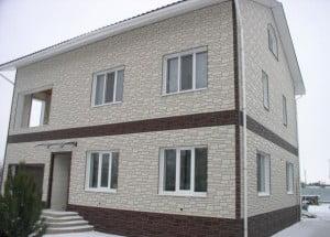 Отделка дома фасадными панелями Wandstein